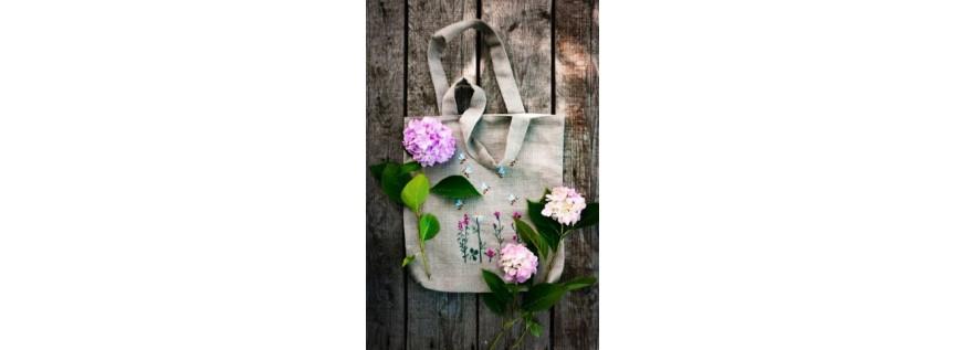 Podložene torbe z ročnim vezenjem